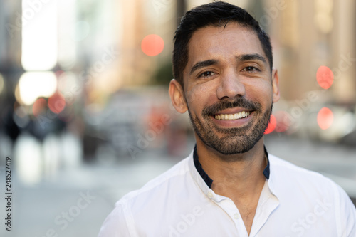 Photographie  Young Latino Hispanic man in city smile happy face