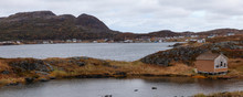 Small Town On The Atlantic Ocean Coast During A Cloudy Morning. Goose Cove East, Saint Anthony, Newfoundland, Canada.