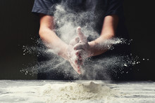 Clap Hands Of Baker With Flour In Restaurant Kitchen