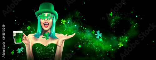 St. Patrick's Day. Leprechaun model girl with pint of green beer over dark green background, decorated with shamrock leaves. Patrick Day celebration