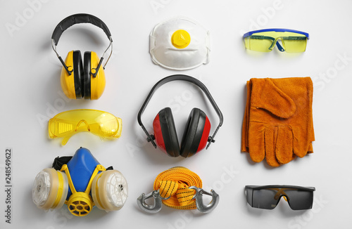 Photo Flat lay composition with safety equipment on white background