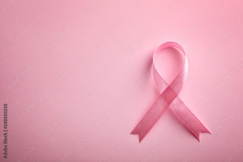 Fototapeta Pink ribbon on color background, top view with space for text. Breast cancer awareness concept