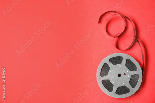 Movie reel on color background, top view with space for text Fototapet