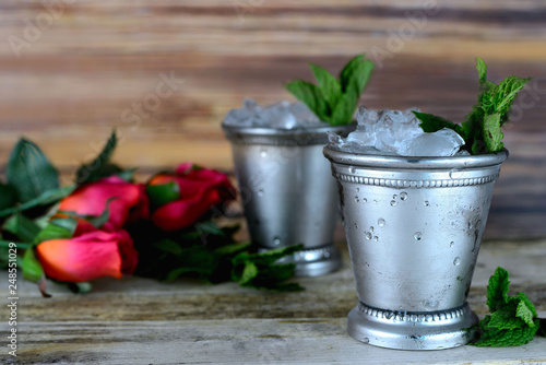 Valokuvatapetti Image for Kentucky Derby in May showing two silver mint julep cups with crushed