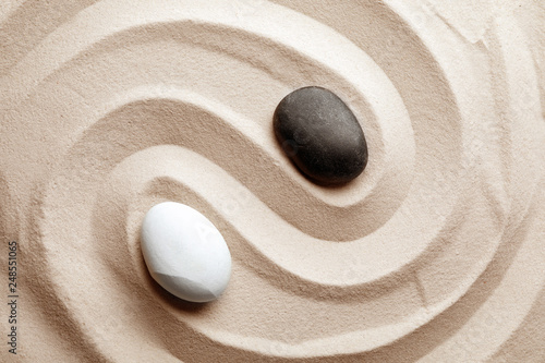 Photo sur Plexiglas Zen pierres a sable Zen garden stones on sand with pattern, top view. Meditation and harmony