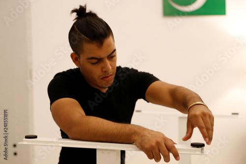 TaskRabbit Tasker Guillermo Rodriguez assembles an IKEA