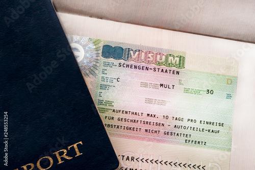Photo Two travelers passports with a Schengen visa
