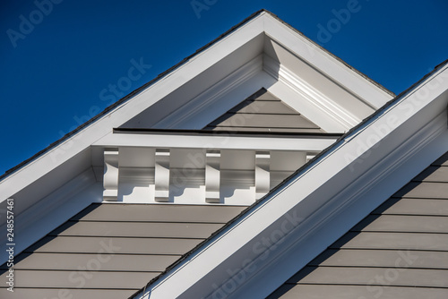 Fotografia, Obraz Plastic or wood roof decoration gable, corbel on a new construction luxury Ameri