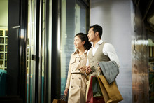 Asian Couple Looking Into Shop...