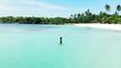 Aerial: Beautiful Young Woman in Bikini Walking in the Ocean by Stunning Beach
