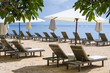 Empty beach chairs and umbrellas on a beach of Sanur in Bali, Indonesia