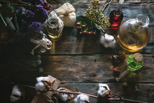 Herbal Medicine Essential Oil On A Table. Witchcraft Background With Copy Space.