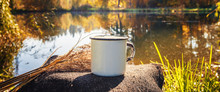 White Cup With A Drink On A Stump Near The Lake, The Idea Of Breakfast In Travel Tourism, A Long Banner