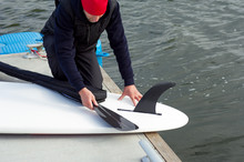 Man Pulling Carbon Paddle Out Of Its Boot