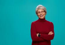 Senior Woman On Teal Background