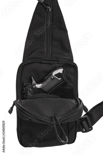 Fotografía  tactical shoulder with a gun inside the bag on a white