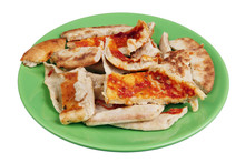 Slices Of Dried Italian Pizza On A Green Plate Isolated
