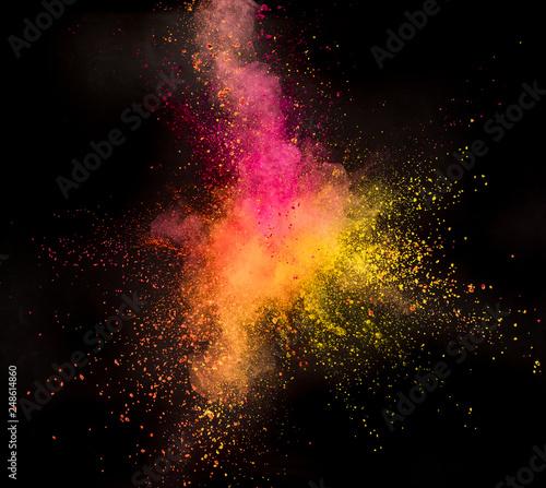 Fototapeta Colored powder explosion on black background. Freeze motion. obraz na płótnie