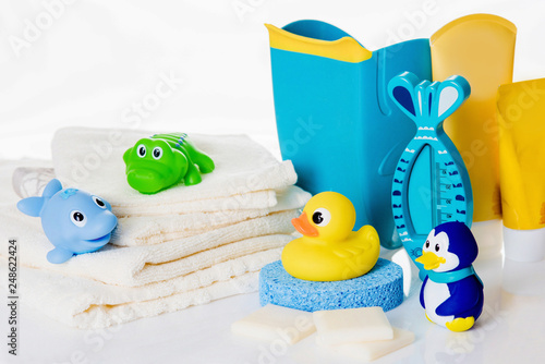Obraz Still life with baby hygiene and bath items,    towel, pacifier, rubber toy, thermometer - fototapety do salonu
