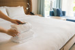 PHU QUOC, VIETNAM JUNE 28, 2017: Cropped image of a female chambermaid making bed in hotel room