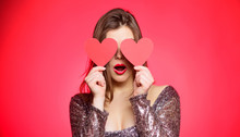 Woman In Stylish Dress Hold Symbol Love. Romantic Mood. Girl In Love Dating. Obsession Concept. Fall In Love. Girl Adorable Fashion Model Makeup Face Hold Heart Valentines Card. Love From First Sight