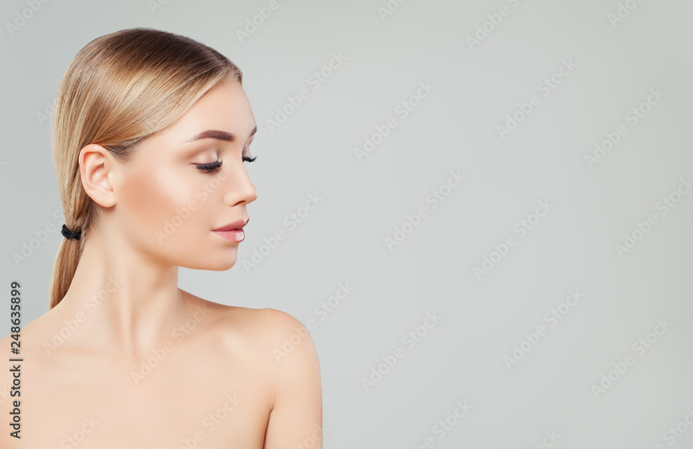 Fototapeta Beautiful blonde woman face, female profile on white background. Facial treatment, skin care and cosmetology concept
