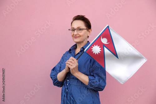 Nepal flag  Woman holding Nepalese flag  Nice portrait of