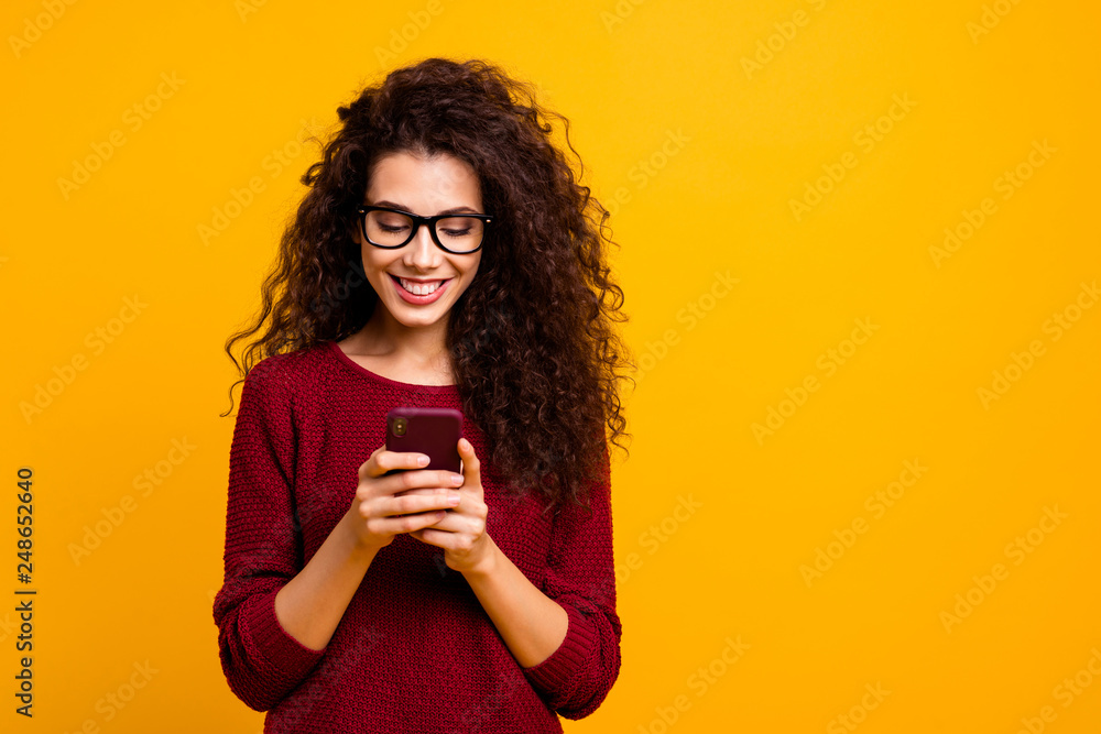 Fototapety, obrazy: Portrait of her she nice lovely attractive pretty cheerful cheery wavy-haired lady holding in hands cell playing game free time isolated over bright vivid shine orange background