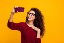 Portrait Of Her She Nice Cute Attractive Cheerful Cheery Wavy-haired Lady Holding In Hands Cell Making Taking Selfie Photo Capturing Isolated On Bright Vivid Shine Orange Background