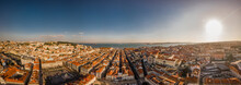 Bird In Flight At Sunset Over Lisbon, Portugal. View To Tagus River.