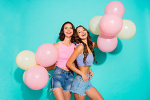 Close Up Portrait Two Amazing Beautiful Wavy She Her Lady Cheerleaders Colorful Balloons Hands Arms Supporting Toothy Wearing Colored Shiny Shorts Tank Tops Isolated Teal Bright Vivid Background