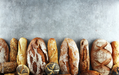 Foto op Plexiglas Bakkerij Assortment of baked bread and bread rolls on stone table background