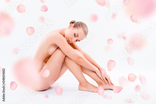 Obraz Side view photo pretty nude healthy beautiful she her woman ideal perfect clean flawless skin closed eyes sitting floor hugging legs pampering isolated pink white background - fototapety do salonu