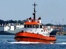 Red Tugboat Underway In Harbou...