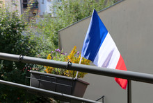 Small French Flag On A Balcony