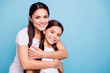 canvas print picture - Close up photo pretty two people brown haired mum small little daughter best friends stand hugging piggy back lovely nice free time rejoice wearing white t-shirts isolated on bright blue background