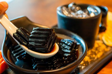 Grass Jelly Of A Type Of Thai Dessert On White Spoon With Sweets,caramel  As Yummy Traditional Asian Food Thailand