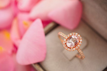 Elegant Wedding Diamond Ring In Jewelry Box On Beautiful Pink Rose Petal Background Close Up