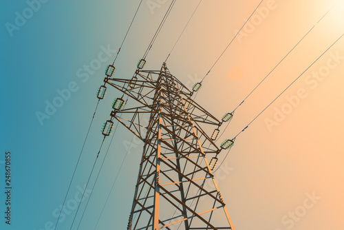 Electric power pylon and overhead lines tower used transmit electrical energy - fototapety na wymiar