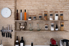 Kitchen Bench Shelves With Various Food Ingredients On Brick Background