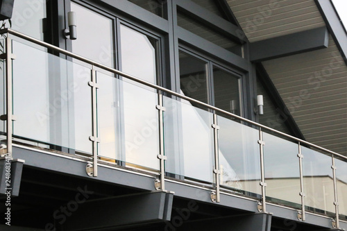 Fotografie, Obraz Balcony railing made of glass and stainless steel