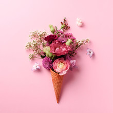 Summer Minimal Concept. Ice Cream Cone With Pink Flowers And Leaves On Punchy Pastel Background. Flat Lay. Top View. Creative Layout. Square Crop