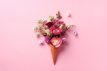 Summer Minimal Concept. Ice Cream Cone With Pink Flowers And Leaves On Punchy Pastel Background. Flat Lay. Top View. Creative Layout