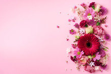 Spring Composition Of Pink Flowers On Punchy Pastel Background With Copy Space. Creative Layout. Flat Lay. Top View. Summer Minimal Concept.