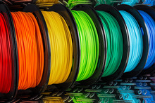 Colorful Bright  Row Of Spool 3d Printer Filament Black Metal Background