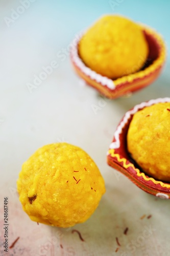 Photo  Homemade Laddu / Ladoo - Indian Diwali festival sweets close up, selective focus