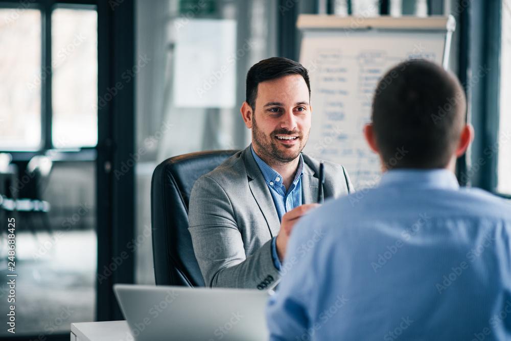 Fototapeta Two business men on meeting.