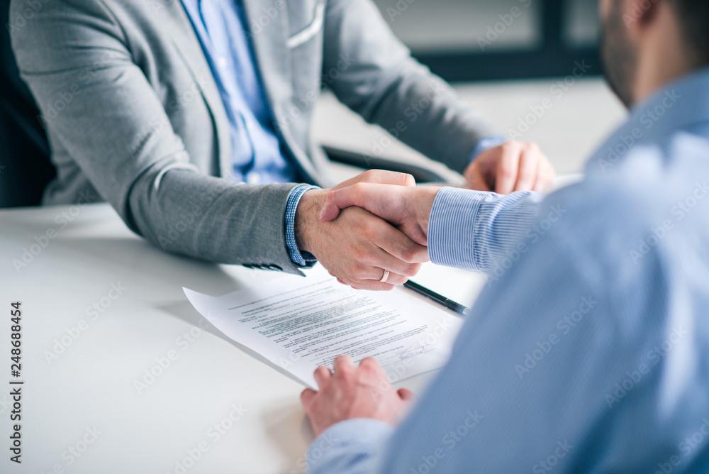 Fototapeta Business partnership concept. Cropped image of two businessmen handshake.
