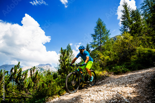 Foto op Aluminium Fietsen Tourist cycling in Cortina d'Ampezzo, stunning rocky mountains on the background. Man riding MTB enduro flow trail. South Tyrol province of Italy, Dolomites.