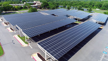 Aerial View Solar Panels In Parking